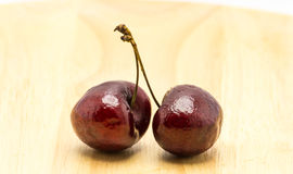 Cherry on wood dish Royalty Free Stock Image