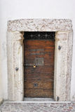 Cherry wood door. With ancient seratura step for access Royalty Free Stock Image