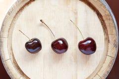 Cherry On Wood Stock Image
