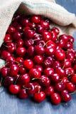 Cherry on wood Stock Photography
