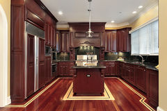 Cherry wood new kitchen. Cherry wood kitchen in new construction home Royalty Free Stock Photos