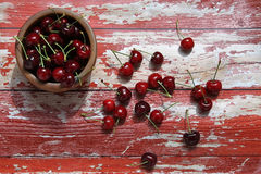 Cherry on the wood. Ripe red cherries on the old red wood background Royalty Free Stock Images
