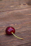 Cherry on a wooden background Royalty Free Stock Images