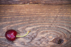 Cherry on a wooden background Royalty Free Stock Photo