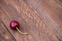 Cherry on a wooden background Royalty Free Stock Photos