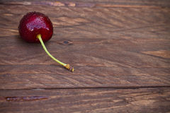 Cherry on a wooden background Royalty Free Stock Photography