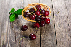 Cherry on wooden background Royalty Free Stock Photos