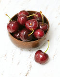 Cherry in a wooden bowl Royalty Free Stock Photos