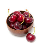 Cherry in a wooden bowl Stock Photo