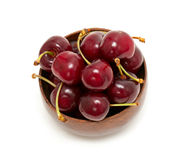 Cherry in a wooden bowl Royalty Free Stock Photo