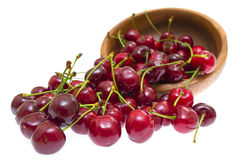 Cherry in wooden bowl isolated on white background Stock Images