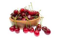 Cherry in wooden bowl isolated on white background Royalty Free Stock Photos