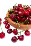 Cherry in wooden bowl isolated on white background Royalty Free Stock Photo