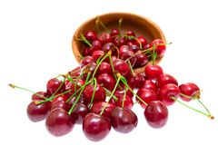Cherry in wooden bowl isolated on white background Royalty Free Stock Images