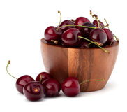 Cherry in wooden bowl Stock Photography