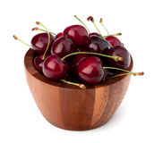 Cherry in wooden bowl Royalty Free Stock Images
