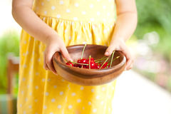 Cherry in wooden bowl Stock Image