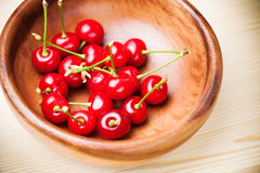 Cherry in wooden bowl Royalty Free Stock Photos