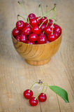 Cherry in wooden bowl Royalty Free Stock Image