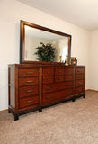 Cherry wooden dresser with a mirror Royalty Free Stock Images