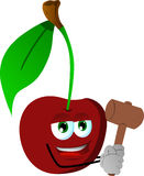 Cherry with a wooden hammer Royalty Free Stock Photography