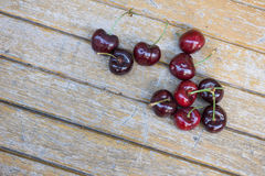 Cherry on wooden table  background Royalty Free Stock Photos