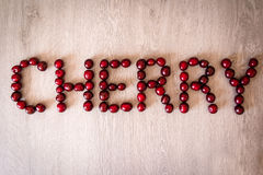 Cherry word Stock Photography