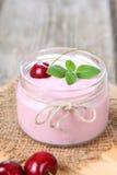Cherry yogurt and cherry Royalty Free Stock Image