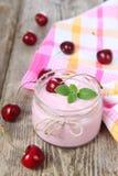 Cherry yogurt and cherry Stock Images