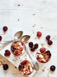 Cherry and yogurt chia pudding parfait. Cherry and yogurt smoothie in a glass top view Stock Photography