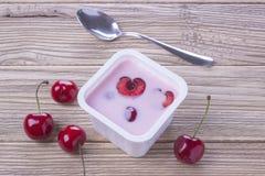 Cherry yogurt in plastic box stock images