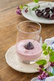 Cherry yogurt and ripe cherry with a sprig of Stock Photo