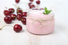 Cherry yogurt and ripe cherry Royalty Free Stock Photos