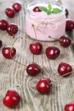 Cherry yogurt and ripe cherry Stock Image