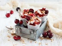 Cherry and yogurt chia pudding parfait. Cherry and yogurt smoothie in a glass close up Stock Photos