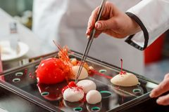 Cherry, yogurt spheres and cake