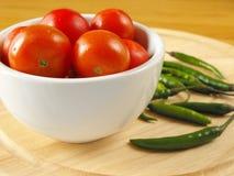 Cherrychilin pepprar tomater Fotografering för Bildbyråer