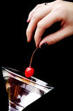 Cherryexponeringsglas martini Arkivbild