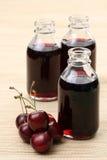 Cherryfruktsaft arkivbild