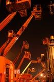 Cherrypickers em a noite Foto de Stock Royalty Free