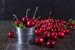 Cherrys in a decorative bucket stock photo