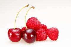 Cherrys e lamponi Fotografia Stock