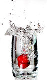 Cherrys splashing into a glass Stock Photo