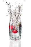 Cherrys splashing into a glass Royalty Free Stock Photography
