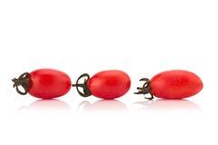 Cherrytomater som isoleras på vit bakgrund Royaltyfria Bilder