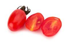 Cherrytomater som isoleras på vit bakgrund Arkivbild