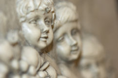 Cherub. Close up of Cherub angels in stone carving Royalty Free Stock Images
