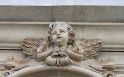 Cherub ancient sculpture on the wall of Pisa Stock Images