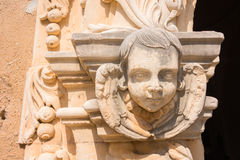 Cherub Angel. Architectural detail carving of angelic cherubim on exterior of Spanish Mission San Jose in San Antonio, Texas stock image