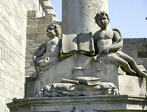 Cherub angels with holy book Royalty Free Stock Image